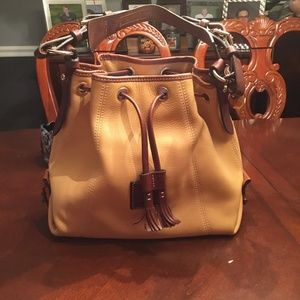 DOONEY & BOURKE PURSE. WILL OFFER FREE SHIPPING !!